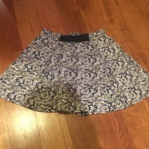 Floral black and white skirt. Black ribbon front